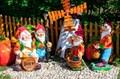 Садовая фигурка полистоун Гном на бочке - фото 37254